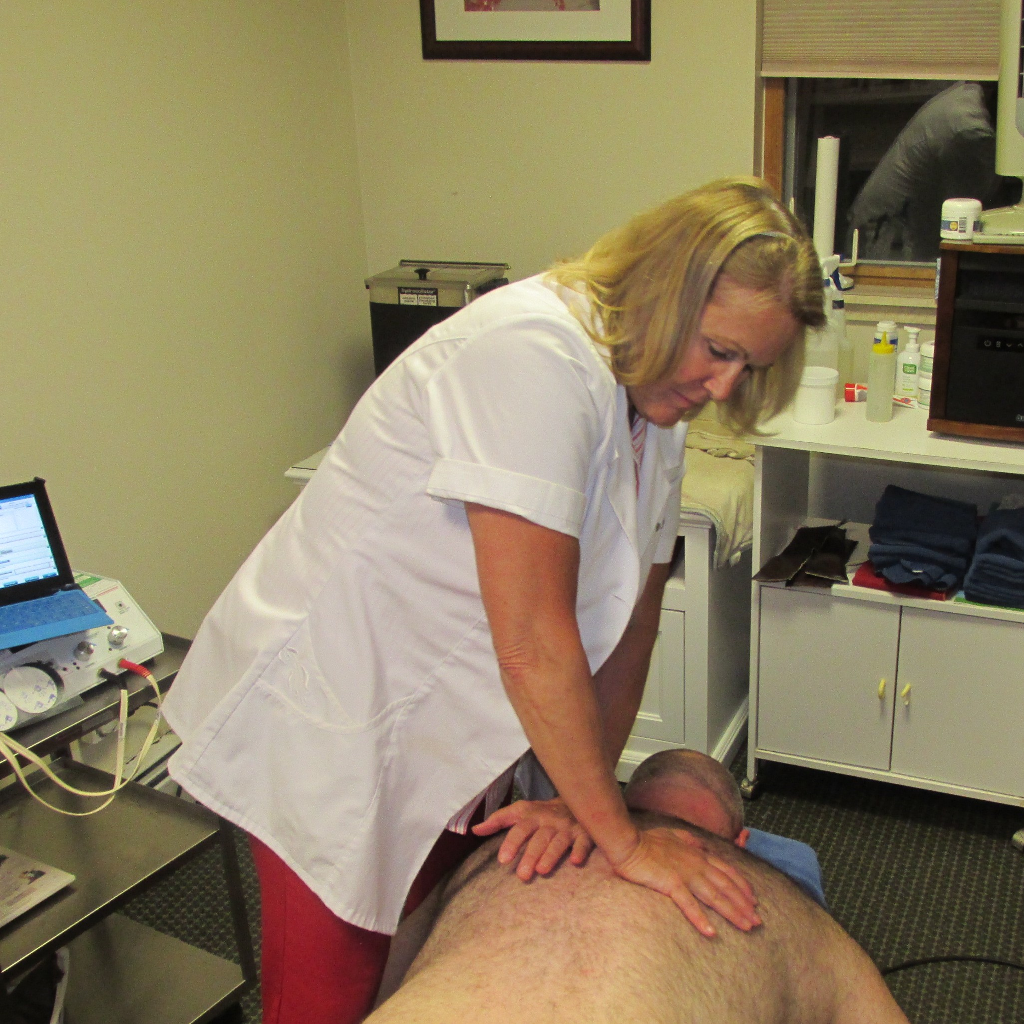 Dr. Mary Negri Chiropractor Adjusting Patient